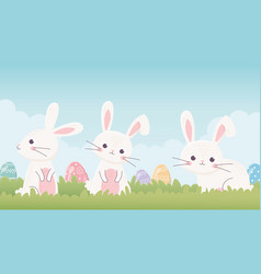 Happy easter cute bunnies with eggs in grass vector