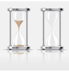 Sand falling in the hourglass on dark background vector