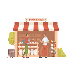 seller shows souvenirs to buyer in market store vector image