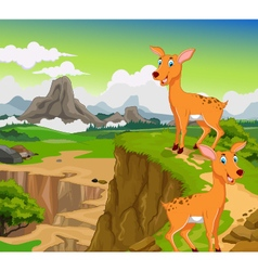 funny two deer cartoon with beauty mountain vector image