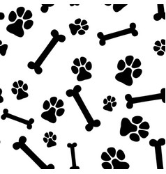 seamless background - pet paw print and bone vector image vector image