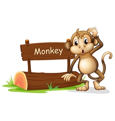 A monkey beside a sign board vector image