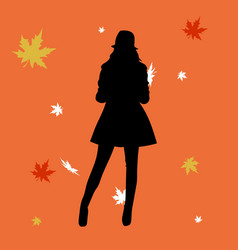 woman silhouette in leaves in the autumn vector image