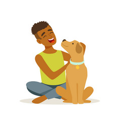 Happy teenager boy stroking friendly brown puppy vector