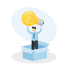 man standing in box and holding glowing lightbulb vector image