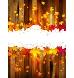 Maple leaves on wooden background plus EPS10 vector image