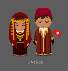 Tunisians in national dress with a flag vector