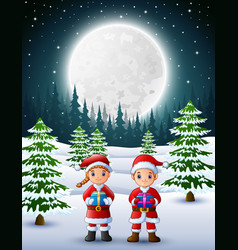 two kids in santa claus holding a gift box with wi vector image