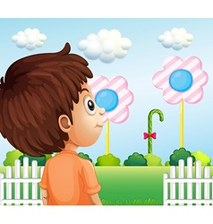 A child looking at the lollipop vector