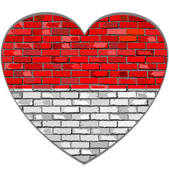 Flag of indonesia on a brick wall in heart shape vector