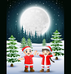 two kids wearing a red santa waving and laughing o vector image