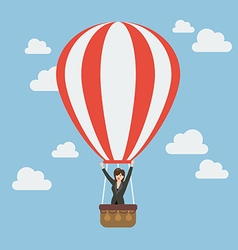 Business woman celebrating in hot air balloon vector image vector image