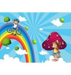 A boy biking in the rainbows vector image vector image