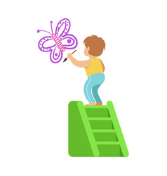 cute little boy standing on a ladder and painting vector image
