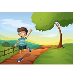 A young boy waving his hand while running vector