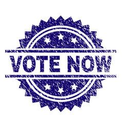 Grunge textured vote now stamp seal vector