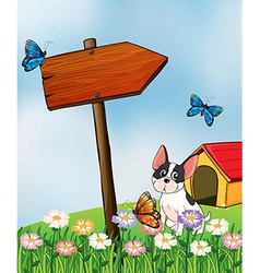 Dog and butterflies in the garden vector image vector image