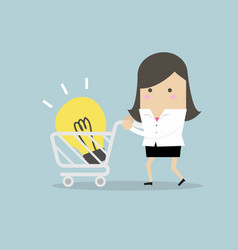 businesswoman with shopping carting and light bulb vector image