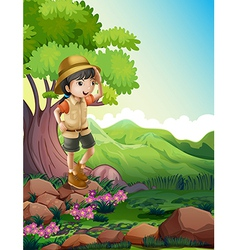 A girl standing above the rock near the giant tree vector