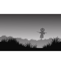 Silhouette of halloween scarecrow in fields vector image