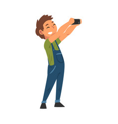 Smiling boy in overalls taking selfie photo cute vector