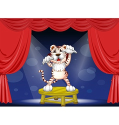 A tiger above a round table vector image
