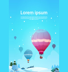 colorful air balloons flying in sky over winter vector image vector image