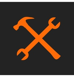 Crossed orange tools on black vector image