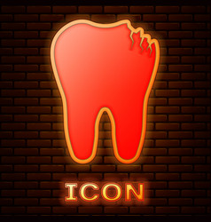 Glowing neon broken tooth icon isolated on brick vector