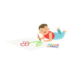happy little boy lying on the floor and drawing on vector image vector image