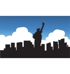 Silhouette of statue liberty blue sky vector image