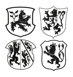 Heraldic lions on shields vector