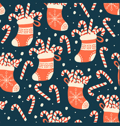 Christmas seamless pattern with candy cane vector