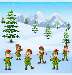 Happy kid wearing elf costume in snowing hill vector