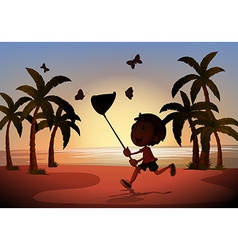 Silhouette boy catching butterflies vector image
