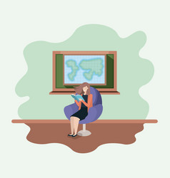 classroom with female teacher reading book in the vector image