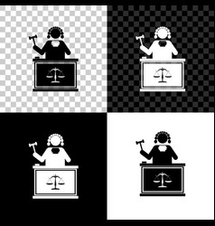 Judge with gavel on table icon isolated on black vector
