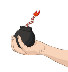 Childs hand holding bomb vector