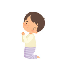 Little boy character praying standing on his knees vector