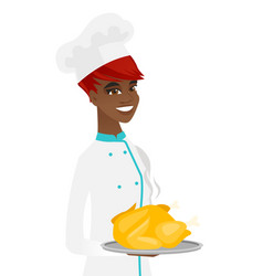 Young african chef holding roasted chicken vector