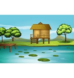 A hut at the riverbank vector