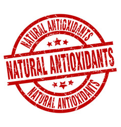 natural antioxidants round red grunge stamp vector image