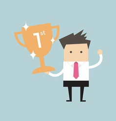 Businessman holding winning trophy vector image