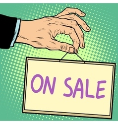 Hand holding a sign on sale vector