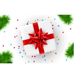 present box with red ribbon and christmas tree vector image