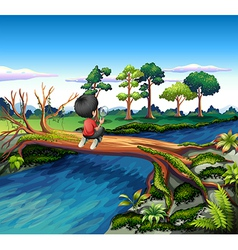 A boy above the trunk of a tree holding a vector image