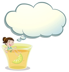 A smiling child swimming on a glass of lemonade vector image