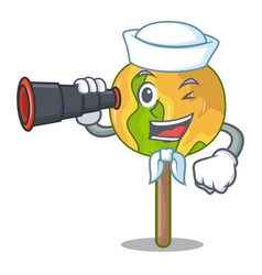 Sailor with binocular candy apple mascot cartoon vector