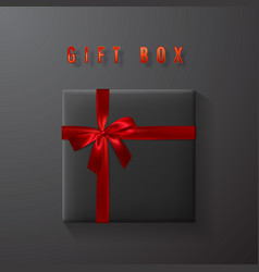 black gift box with red bow and ribbon top view vector image