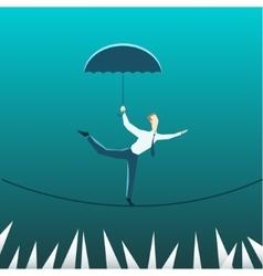 Businessman with an umbrella over the precipice vector image